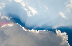 Iridescence, Nice rainbow at clouds with sunshine Stock Photography