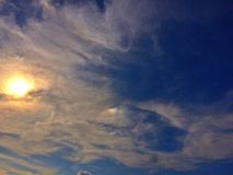 Iridescent cloud and sunlight Stock Photography