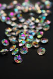 Iridescent color gems on a black Royalty Free Stock Photo