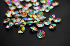 Iridescent color gems on a black Royalty Free Stock Photography