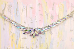 Iridescent crystal necklace on fine art background. Iridescent multi colored aurora borealis rhinestone necklace on abstract fine art background Stock Images
