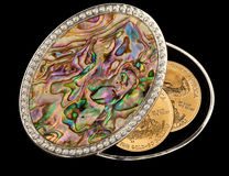 Iridescent mother of pearl box gold coins Stock Photo