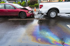 Iridescent oil spill caused by a traffic accident Royalty Free Stock Photography