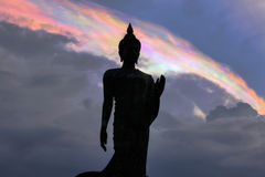 Iridescent pileus cap clouds and Buddha statue at PhutthamonthonBuddhist park in Phutthamonthon district,Nakhon Pathom Province o Royalty Free Stock Photos