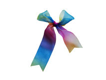 Iridescent ribbon. The iridescent ribbon is fastened on a small knot Stock Image