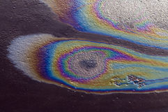 Iridescent spot of gasoline on the pavement Stock Photo