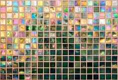 Iridescent Tile Wall. A wall of iridescent green tiles Royalty Free Stock Photography