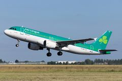 Aer Lingus Airbus A320-200. Irish Aer Lingus Airbus A320-200 with registration EI-DVG taking off runway 36L Polderbaan of Amsterdam Airport Schiphol royalty free stock images