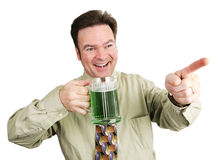 Irish-American Guy on St Patricks Day. Irish American guy drinking beer to celebrate St. Patrick's Day.  Isolated on white Stock Photography