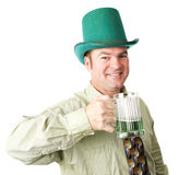 Irish American Man on St Patricks Day. Handsome Irish American man celebrating St Patrick's Day with green beer.  Isolated on white Royalty Free Stock Photo