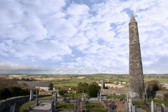 Irish Ancient round tower and celtic graveyard with cathedral Royalty Free Stock Image