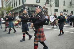 Irish bagpipers march Royalty Free Stock Photos