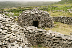 Irish Beehive Stone House. A medieval beehive stone house on the Dingle Peninsula in Western Ireland. This traditional stone construction used rocks to make safe stock photo