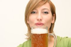 Irish beer. Smiling woman drinking a big glass beer Stock Image
