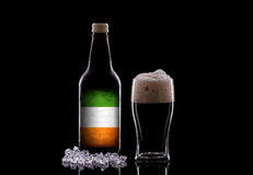Irish Beer. A Pint of Dark Beer and a Beer Bottle on a Black Background. Irish Beer Concept Stock Images