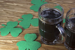 Irish beer for St Patick's Day and clover leaves Royalty Free Stock Image