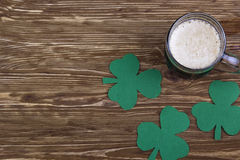 Irish beer for St Patick's Day and clover leaves Stock Image