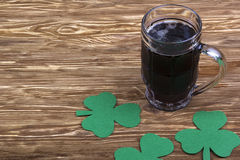 Irish beer for St Patick's Day and clover leaves Royalty Free Stock Images