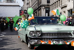 Irish boy in st patrick day parade on london. An Irish boy saying hello trough the window of a classic car in london's st patrick's day Stock Images