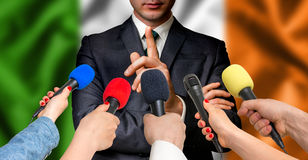 Irish candidate speaks to reporters - journalism concept Stock Photo