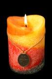 Irish candle 6. The fragranced irish candle shot on a black background Stock Photos