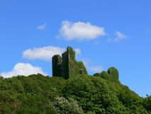 Irish castle ruin. Ancient ivy covered Dunhill castle Co.Waterford, Ireland Stock Image
