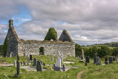 Irish cemetery with dilapidated church, County Kerry, Ireland. Europe - litte church without roof royalty free stock image