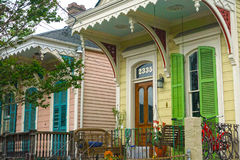 Irish Channel Shotgun Houses. Colorful and fun classic shotgun style homes with sitting porches side-by-side in the Irish Channel Neighborhood of New Orleans stock photos