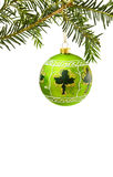 Irish Christmas border with lucky shamrock. Celebrating Christmas in Ireland with traditional pine tree branch, green hand painted bauble and lucky shamrock Royalty Free Stock Photography