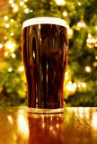 Irish Christmas with pint of black beer Royalty Free Stock Photography