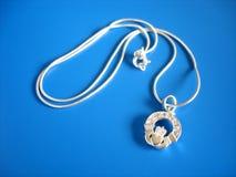 Irish Claddagh Love Symbol. Traditional Irish Claddagh symbol on a silver chain Royalty Free Stock Image