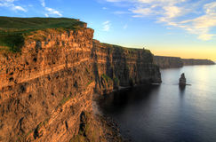 Irish cliffs.. Cliffs of Moher at sunset - Ireland Royalty Free Stock Images