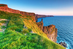 Irish Cliffs of Moher at sunset. Cliffs of Moher at sunset in Co. Clare, Ireland Stock Image