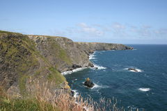 Irish cliffs scenery. Sharp coastline, cold sea - but scenery is more romantic than anywhere else Stock Photos