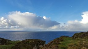 Irish coast and cloud in the sky Royalty Free Stock Image