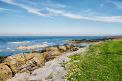 Irish Coastline. Rocks at the waterline at the irish coast stock photo