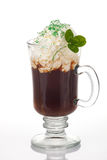Irish Coffee. Mug of Irish Coffee with green sprinkles and clover leaf for St Patrick's Day Royalty Free Stock Photo