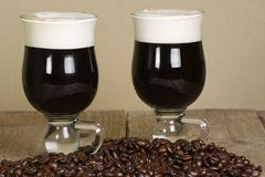 Irish coffee. Two glass cups of irish liquer coffee with coffee beans Royalty Free Stock Photography