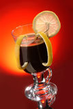 Irish Coffee. Glass of coffee with lemon on the red glass royalty free stock photography