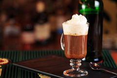 Irish coffee in a bar. Concept of St Patrick holiday. Holiday ba. Ckground. Irish national day. Warm tone. Horizontal Royalty Free Stock Photography