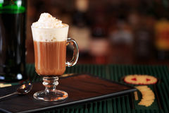 Irish coffee in a bar. Concept of St Patrick holiday. Holiday ba stock photography