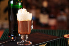 Irish coffee in a bar. Concept of St Patrick holiday. Holiday ba Stock Photos