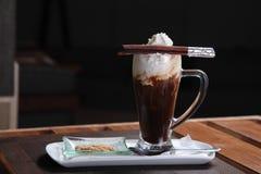 Irish coffee with chinnamon stick Royalty Free Stock Photography
