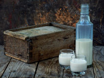 Irish coffee cream liqueur Baileys in glass and botle on wooden background. Selective focus. Copy space Royalty Free Stock Photo
