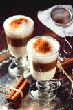 Irish coffee cup filled latte poured layers on the metal tray.  Royalty Free Stock Photos