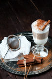 Irish coffee cup filled latte poured layers on the metal tray Stock Photography
