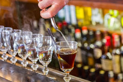 Irish Coffee at the famous Buena Vista cafe in San Francisco. San Francisco, USA - May 2, 2014: Irish Coffee drinks being made on the bar counter at the famous Royalty Free Stock Photos