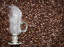 Irish coffee glass with smoke in coffee beans Stock Photography