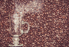 Irish coffee glass with smoke in coffee beans Royalty Free Stock Images