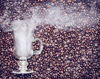 Irish coffee glass with smoke in coffee beans Royalty Free Stock Photo
